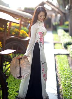 Ao dai = white/cream, black pants.