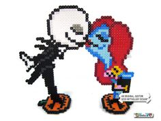 This is Halloween! Or Christmas? Or just a cool party or a unique wedding! This is a pixel art sprite of Jack Skellington and Sally kissing from the