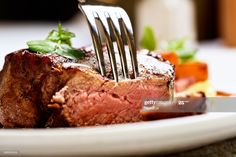 Stock Photo : Tender and juicy, a fork pierces grilled beef fillet Beef Recipes, Cooking Recipes, Game Recipes, Restaurant Steak, Cooking The Perfect Steak, Beef Fillet, Menu, Grilled Beef, Recipe Sites