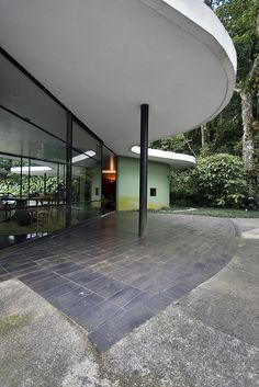 Casa das Canoas Architect: Oscar Niemeyer 1952-53-pavement and overhang detail-technically only one implied volume...