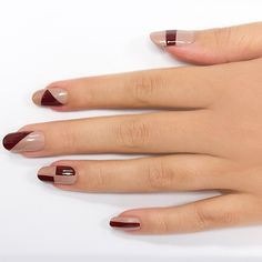 Geo Mod - Start with a base coat and paint all nails with a thin layer of nude polish.With a striping tape, create geometric shapes in varying shapes and sizes on each nail. Paint inside the taped-off shapes with a burgundy nail polish.Peel off tape and seal with a clear topcoat.
