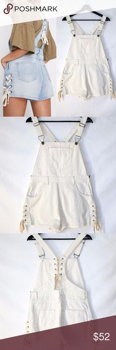 NWT MINKPINK D Denim Mini Overalls White Lace Up New with tag  MINKPINK D  Denim mini overalls with contrast lace up details    Adjustable distressed style straps with bib fastening Bib front with pocket Contrast lace detail on back strap Pockets at hips  Visible zip at side Relaxed shorts with matching lace up sides  100% Cotton Color white Size M  The model is wearing a overalls in the exact same design with a different color MINKPINK Jeans Overalls