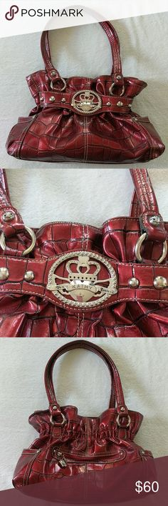 Kathy Van Zeeland Shoulder Bag purse . Kathy Van Zeeland Shoulder Bag purse . Very classy red and black design with silver accessories a pocket on each side and one in the back , inside has one large Zipper pocket , one med opened pocket and two small pockets. The lining is gold with little purse designs on it . Small black spot in back look a the fourth picture , not very noticeable but it's there . Nice clean purse great shape  , gently used . Kathy Van Zeeland Bags Shoulder Bags
