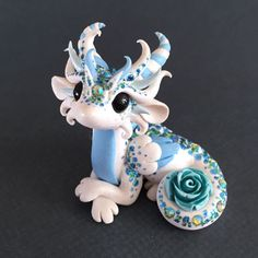 Shimmery-Rose-Dragon-Sculpture-by-Dragons-and-Beasties