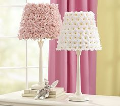 Simply hot glue silk flowers onto any lamp shade.  Super cute and super easy!