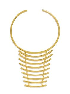 We love the architectural detail of this close-fitting gold collar with its dramatic, ladder-like silhouette.