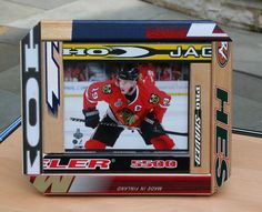 Hockey Picture Frames by Chair Built Custom Woodworking   This would be great for our hockey players