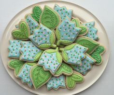Spring tulips, lovely in pink, blue, & green; beautifully embellished green leaves, by Butterfield Cookies, posted at Cookie Connection