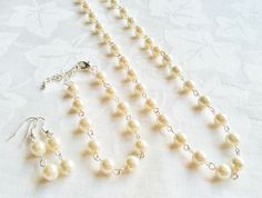 A personal favorite from my Etsy shop https://www.etsy.com/listing/193977666/cream-pearl-necklace-set-pearl-jewelry