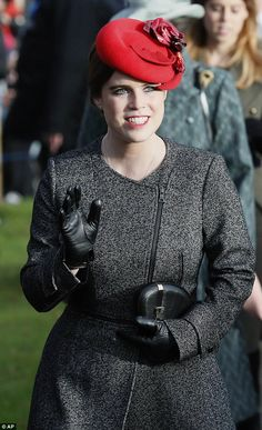 Britain's Princess Eugenie opted for black court shoes, a grey marl coat, black leather gloves, a red felt cocktail hat by Sarah Cant and a black clutch bag by London designer Stacy Chan