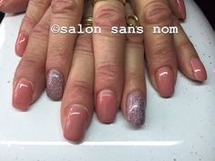 Fibergel nails with pink and glitter.