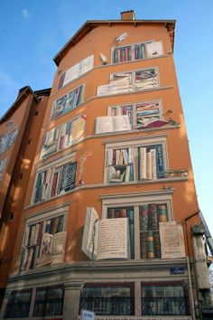 This beautiful fresco adorns the exterior of La Bibliotèque De La Cité (The Library of the City) in Lyon, France.