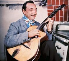 LOVE THIS MAN!    Django Reinhardt (23 January 1910 – 16 May 1953) was a pioneering virtuoso jazz guitarist and composer. He is also revered by guitarists worldwide as among the foremost exponents of the instrument. Reinhardt invented an entirely new style of jazz guitar technique (sometimes called 'hot' jazz guitar) that has since become a living musical tradition within French gypsy culture.