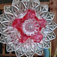 Federal Petal depression glass and an amazing rose crimson pink art glass piece serve as the base for this glass plate flower. If you want to add some lovely charm to your garden , this just may be your flower. It is a very unique piece of garden ART for your home. We love glass and repurposing. This is the perfect combination for both crystal and green.  We are pleased to present one of our No-Kill Ever-Blooming Glass Plate Flowers. No weeding, No watering required. They are always happily…