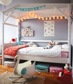 Such a pretty little space for a girl. The canopy and fairy lights are so sweet! ~ 10 Gorgeous Girls Rooms | Tinyme Blog