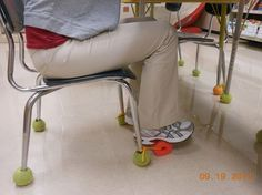 This is a pool noodle attached to the desk with a rope. It can be used as a foot rest or for a sensory strategy for movers and | http://desklayoutideas.blogspot.com