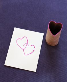 Toilet paper roll heart stamp - perfect for kids Valentine's Day art!