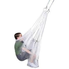 Rhys's net swing is a lot like this one. It's like a simple hammock with both ends connecting to a big hook in the ceiling. It calms him, helps him get rid of some extra energy (he really gets it spinning and swinging!) and gives him the squeezes he loves. It's a favorite of his friends and cousins when they visit, too.