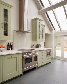 Harvey Jones Shaker kitchen handpainted in Farrow & Ball Cooking Apple Green with composite 'Chalk White' worktop