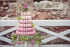 An ombre (dip dye effect) macaron wedding tower from a flower fairy/dip-dye wedding shoots at Askham Hall, Penrith. Photography by Tiree Dawson Photography, Flowers by Valerie Ann's Florist, Windermere Macaron wedding cake, alternative wedding cake, macaroon wedding cake