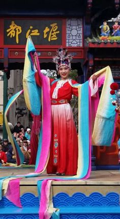 Traditionally adorned Sichuan style dance performer poses for audience on the Chengdu, China Great Panda float at the 90th Macy's Thanksgiving Day Parade