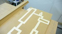 The template will need to be taped down and then traced around. I got my strips there too - these will become the boxes and also the jigs I'll need to help me make this modern mirror.
