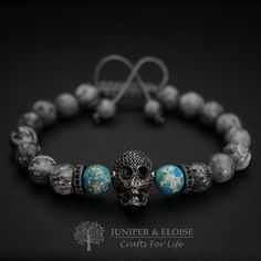 This handmade bracelet is made with 8mm Gray Jasper and Turquoise Variscite beads featuring gunmetal Skull charm and spacer beads embellished with with black Zircon stones. Its adjustable, utilizing a sliding knot made with macrame cord and is easy to put on and take off by