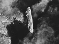 Costa Concordia from space. Disconcerting, yet beautiful photo.