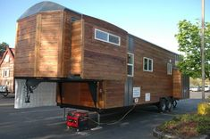 34' Goose neck trailer from Tiny Idahomes -- This would be fantastic to travel with! Renovate a 5th wheel with slide-outs into this! LOVE.