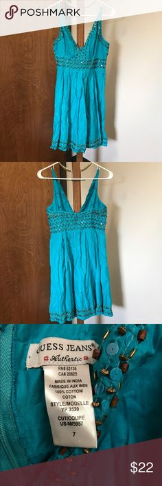 Guess Jeans Sundress Beautiful teal colored sundress by Guess Jeans Authentic. V-neckline, adjustable straps, back zipper with hook-eye closure. Embellished with beads and sequins. 100% Cotton. Pre-owned and loved but in EUC. No visible signs of wear and tear. Guess Dresses
