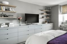 idea for shelving beside bed - like lower shelving - easier to get to everything without needing stool.