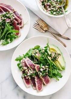 seared ahi tuna with chimichurri sauce, arugula, and avocado.