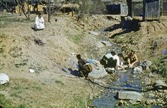 Korean ladies, circa 1960, washing clothes in a stream in an area that is now called Kuneadan, just north of the US 8th Army Main Post in Yongsan, south of Seoul City and Namsan mountain. by smothers52