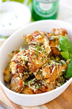 Try making baked Parmesan garlic chicken wings to give this classic dish a tasty twist. Dip them in blue cheese mustard dressing. Click through for recipe.