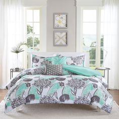 Add a pop color to your space with the Lily Duvet Cover Set. This painterly floral look is a fresh take on floral with its aqua color creating a marker look. Two decorative pillows use embroidery and fabric manipulation to pull this look together.