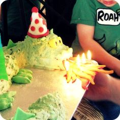 """The candles on this dragon cake come out of his mouth so he's """"breathing fire."""""""