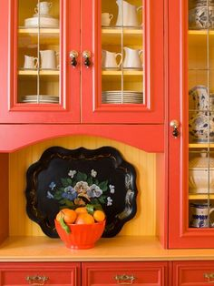 A Portion Of Their Adorable Kitchen Is Bright Orange Charming