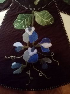One section of table topper, blue sweet peas