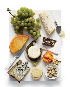 It's a cheese board; it's a centerpiece; it's a place to corral cocktail garnishes. It's a basic white platter (this one's from cb2.com), the most versatile item in your cupboard. Here's a trio of ideas for putting it to good use.