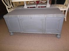 $169 - This vintage cedar chest is ornate with bun feet - original cedar inside. Painted Gray, distressed and finished in tinted wax. ***** In Booth D13 at Main Street Antique Mall 7260 E Main St (east of Power RD on MAIN STREET) Mesa Az 85207 **** Open 7 days a week 10:00AM-5:30PM **** Call for more information 480 924 1122 **** We Accept cash, debit, VISA, Mastercard, Discover or American Express