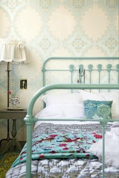 bedrooms - ivory blue wallpaper seafoam green iron vintage bed gray painted table nightstand brass vintage floor lamp  via pinterest  Charming
