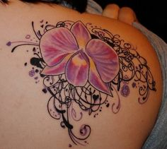 Very pretty flower tattoo - love this.....I had a picture of this very same orchid but she or her artist did a better job......Know one of my tattoo artists he would have suggested the surrounding vines or more flowers