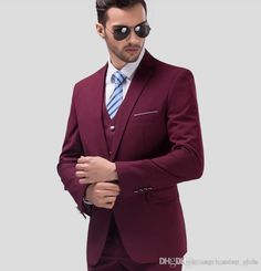Love the maroon suit, I dont know why the tie works so well but it does.