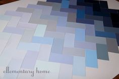 Ombre herringbone tiles. Like the concept for a backsplash, but with more muted colors.