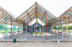 H&P architects constructs colorful re-ainbow community center in vietnam