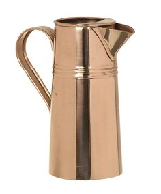 Copper Jug - A quite beautiful solid copper jug - shiny and bright! The jug has a sturdy handle, effective pouring spout and a retaining lip to hold back fruit or ice when pouring. It is further embellished with three raised rings.  Dimensions: 25cm x 24cm x 13cm