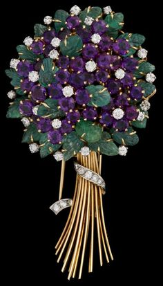 http://rubies.work/0841-ruby-pendant/ 18 karat yellow gold amethyst and emerald brooch, Roger Lucas mid 20th century 'Forget me not' cluster amethyst flowers accented by petite round cut diamond centers, carved leaf cabochons, platinum and diamond set ribbon around yellow gold stems.