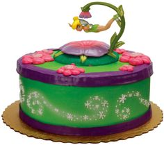 Tinkerbell party theme- love this cake.  Adorable, but not over the top ridiculous.