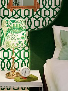 green velvet headboard // Kelly Wearstler Imperial Trellis wallpaper // modern, white lacquer side table great wallpaper for shelves around fireplace