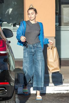 "Make like Miley in denim culottes  Click ""Visit"" to buy #DailyMail"